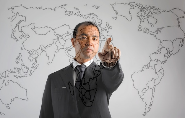 Asian businessman showing on a map