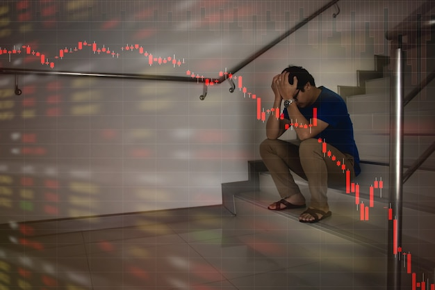 Asian businessman stress and fail from stock market crash fall down trend by economic crisis