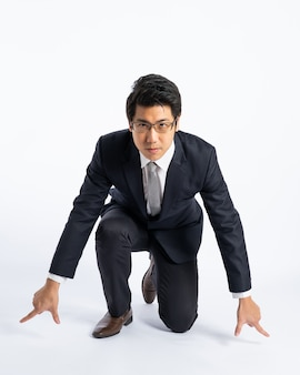 Asian businessman in suit prepare to running