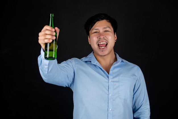 Asian businessman with beer bottle