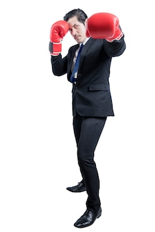 Asian businessman with red boxing gloves fighting