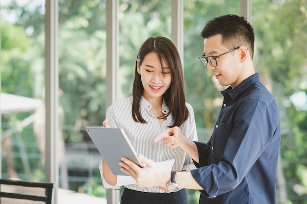 Asian businessman and woman discussing new business project