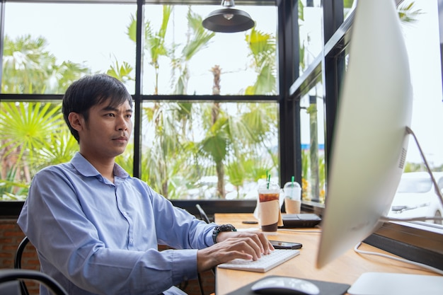Asian businessman working at coffee shop