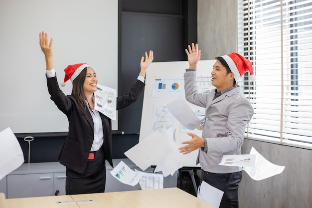 Asian businessmen and businesswomen success and winning   happy team with raised up hands celebrating the breakthrough and achievements