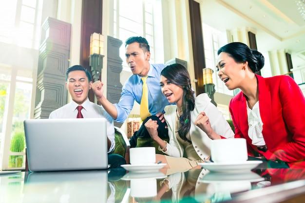 Asian businesspeople having meeting
