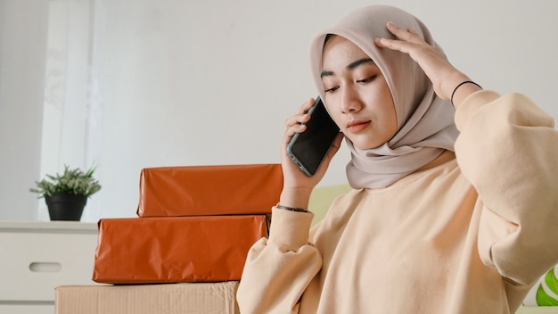 Asian businesswoman confused when contacting