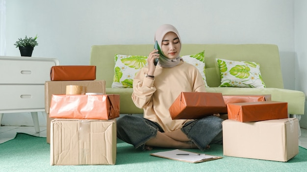 Asian businesswoman contacting customer to confirm order