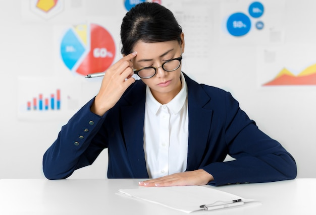 Asian businesswoman curious while working- business and finance concepts.