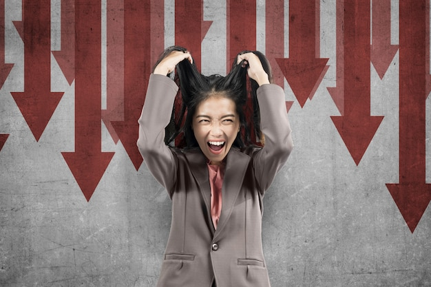 Asian businesswoman feeling depressed with global economic impact