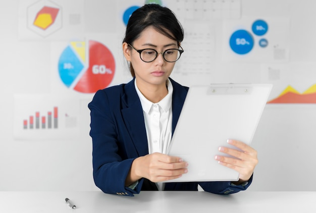 Asian businesswoman pay attention while working