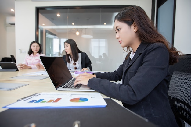Asian businesswoman serious about the work and using notebook
