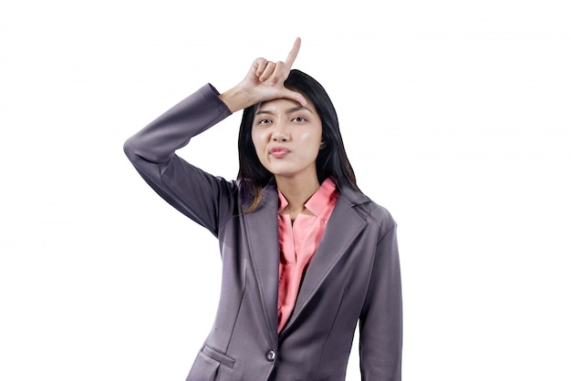 Asian businesswoman showing loser sign