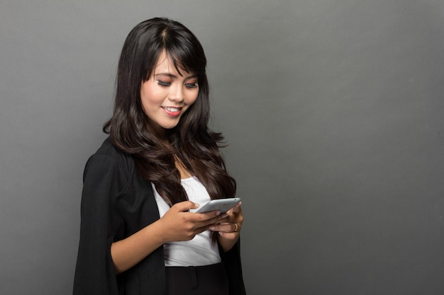 Asian businesswoman with her phone