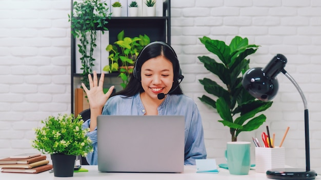 Asian businesswoman working from home with laptop computer
