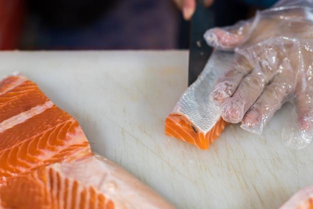 Asian chef slice japanese food sashimi salmon