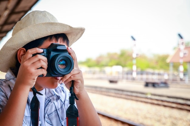 Asian children are taking pictures with a dslr. travel by train.