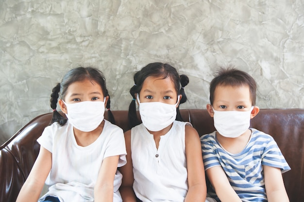 Asian children boy and girls wearing protection mask stay at home quarantine from the coronavirus covid-19 and air pollution pm2.5.
