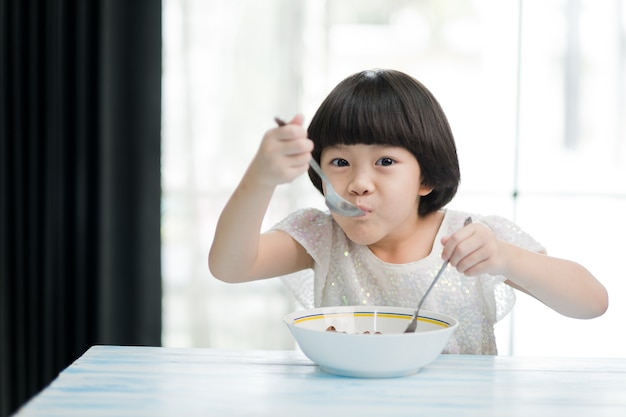 Asian children enjoy eating food