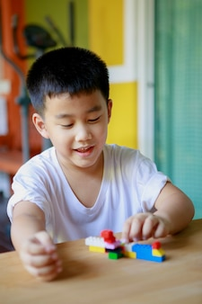 Asian children playing kid toy at home