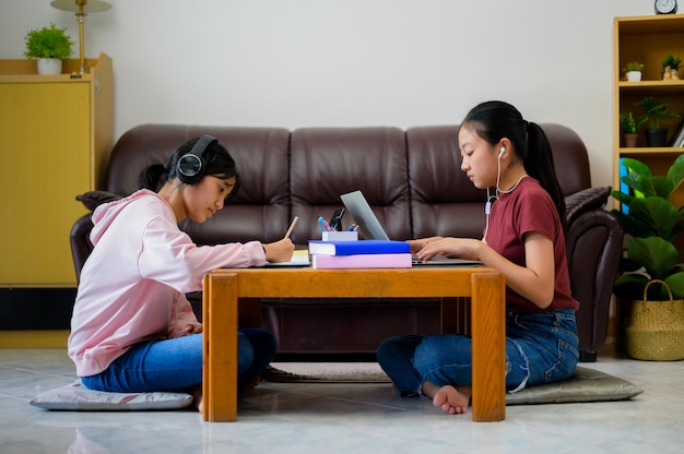 Asian children self study with e-learning at home. online education and self study and homeschooling concept.