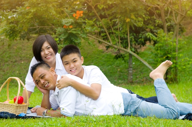 Asian chinese family relaxing at outdoor park