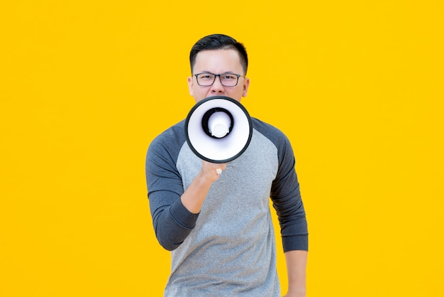 Asian chinese man shouting on megaphone