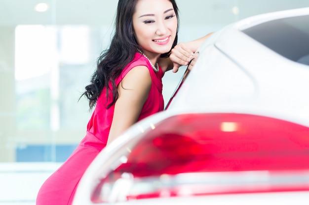 Asian chinese woman buying suv car