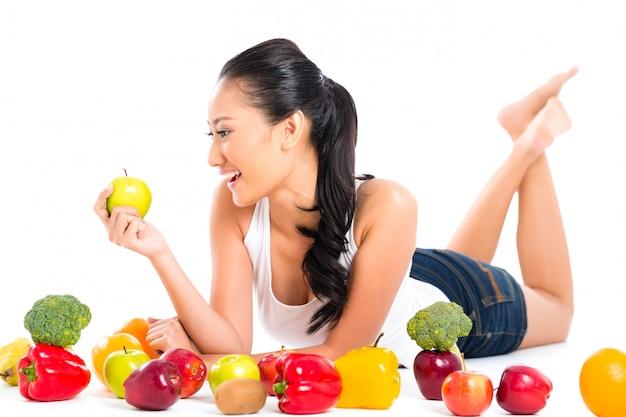Asian chinese woman eating fresh fruit
