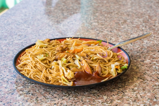 Asian chow mein noodles with chicken meat and vegetables. popular oriental cuisine dish. stock photo.