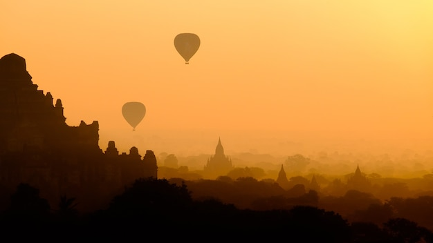 Asian city landscape silhouette with hot air balloons