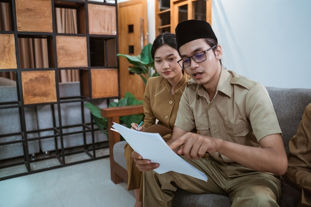 Asian civil worker in uniform meeting with partner