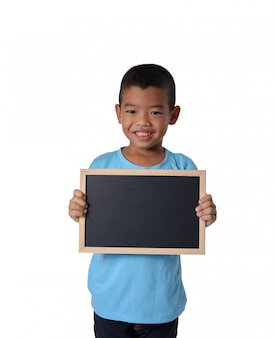 Asian country boy with blank black chalkboard  for education conceptual