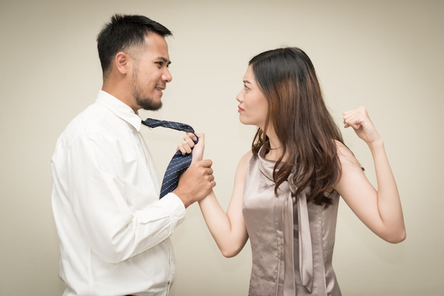 Asian couple fight on isolated background.
