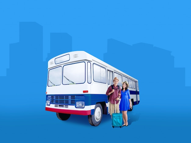 Asian couple in hat with suitcase bag and backpack standing beside the bus