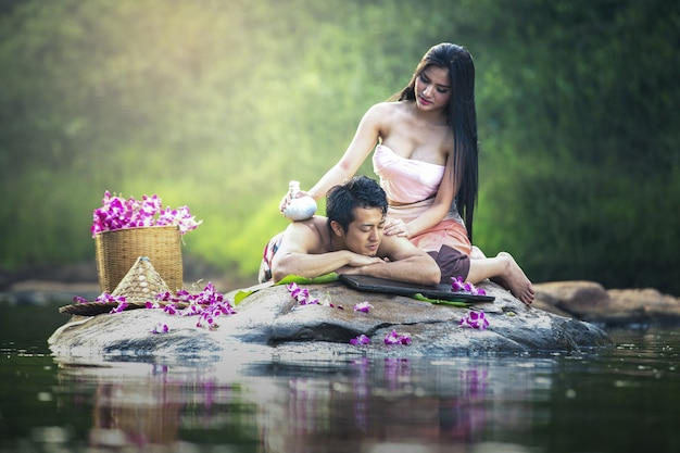 Asian couple having massage and spa salon beauty treatment concept. she is very happy