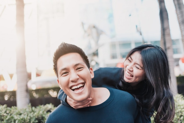 Asian couple in love having fun