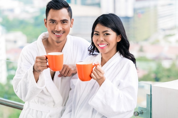 Asian couple in morning front of city skyline