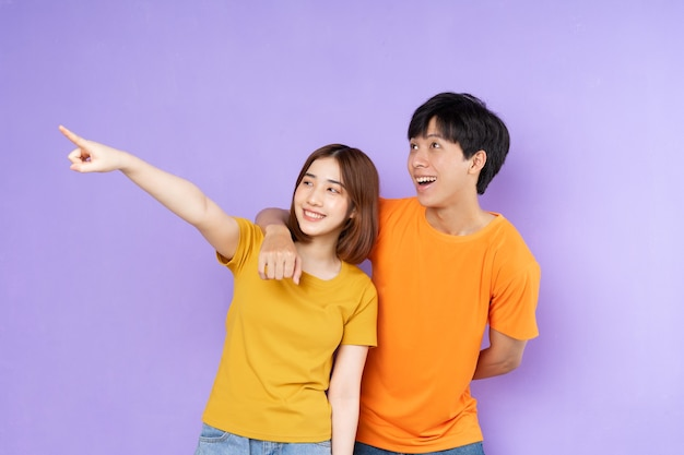 Asian couple portrait, isolated on purple background