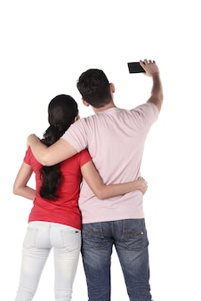 Asian couple selfie with cellphone