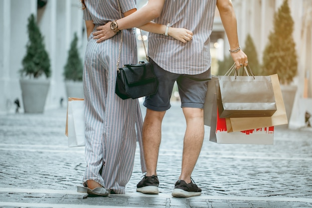 Asian couple shopping happily on holiday.