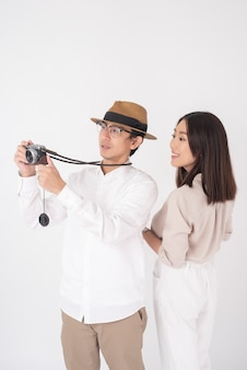 Asian couple tourists are having fun