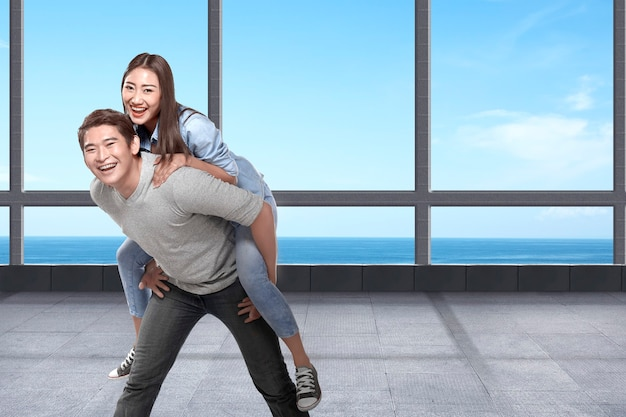 Asian couple traveling to the resort with ocean view