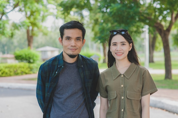 Asian couple walking in the park