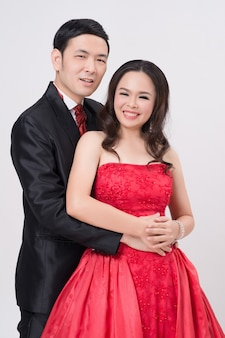 Asian couple wearing evening gown and dress