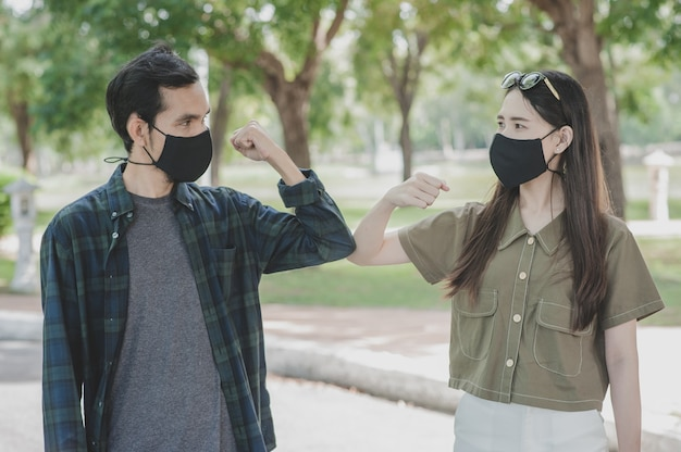 Asian couple wearing medical masks
