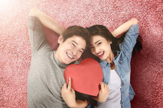 Asian couples holding the red heart