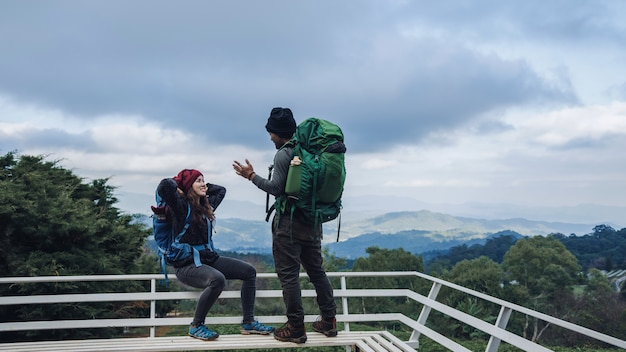 Asian couples travel nature on the mountains in winter.