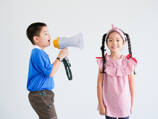 Asian cute boy and girl with megaphone singing