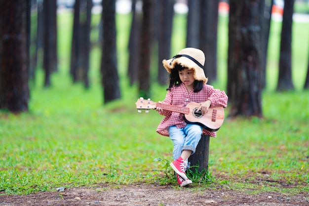 Asian cute girl playing guitar