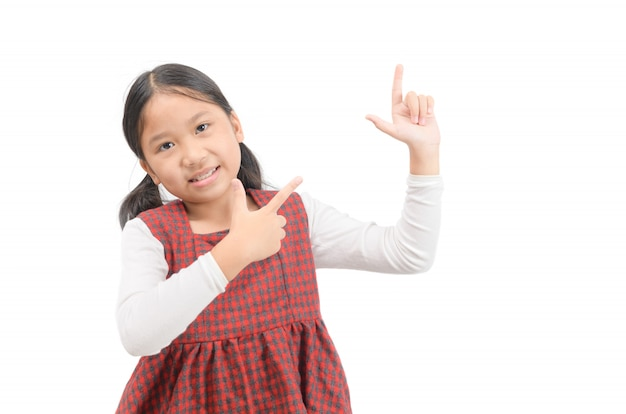 Asian cute girl pointing at empty space isolated on white.